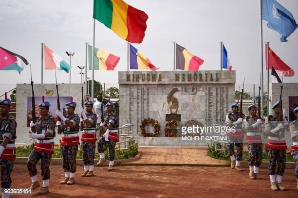 A guard of honour of the Bangladeshi military police contingent parade in front of a commemorative memorial during the ceremony of Peacekeepers' Day...