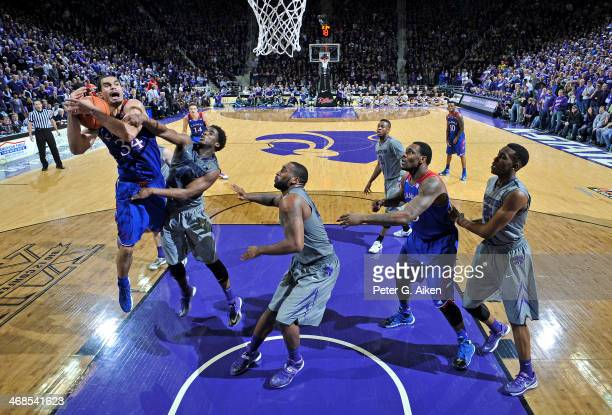Guard Omari Lawrence of the Kansas State Wildcats fouls forward Perry Ellis of the Kansas Jayhawks during the second half on February 10 2014 at...