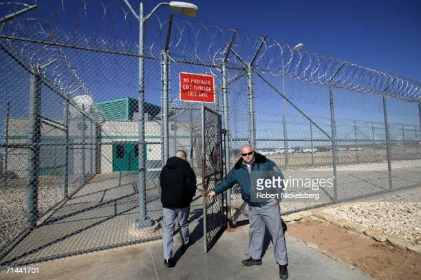 A guard on duty at the Robertson Unit maximum security prison facility opens the main entry gate on January 11 2006 in Abilene Texas Part of the...