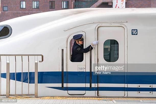 Guard on Shinkansen bullet train in Kyoto Station