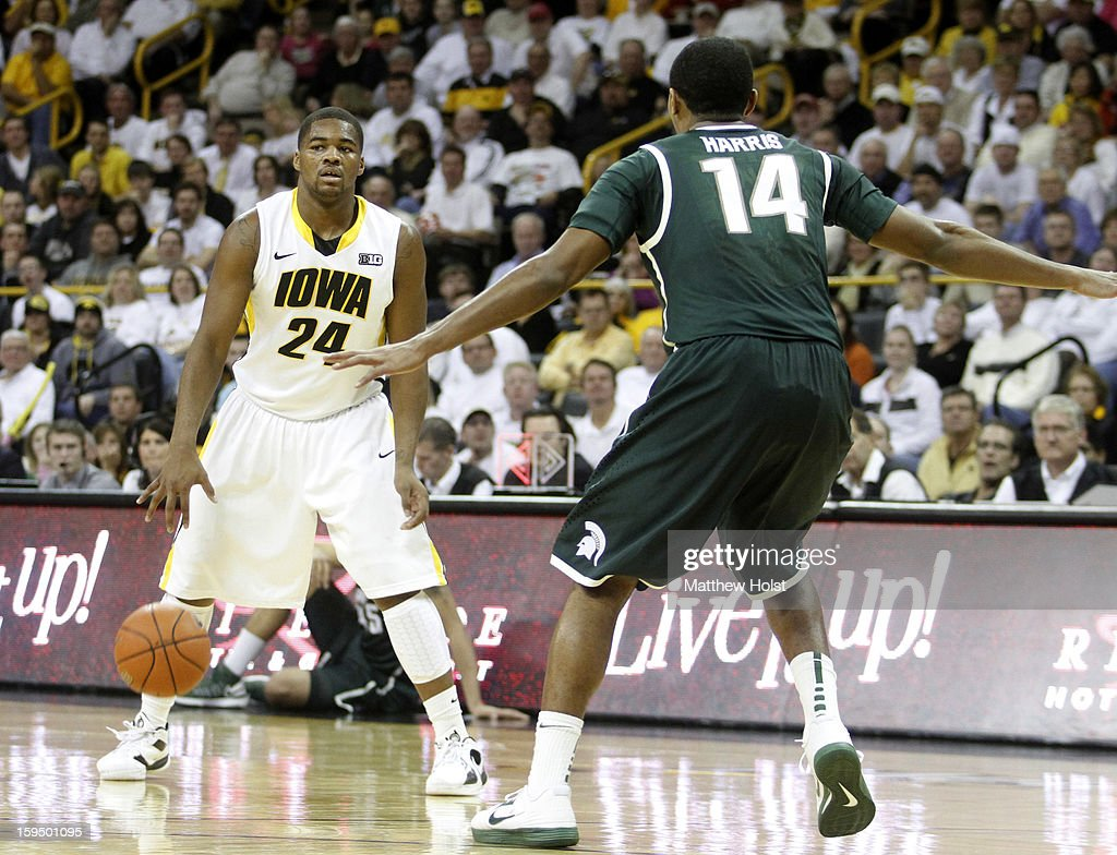 Guard Pat Ingram #24 of the Iowa Hawkeyes brings the ball down the court during the second half against guard Gary Harris #14 of the Michigan State Spartans on January 10, 2013 at Carver-Hawkeye Arena in Iowa City, Iowa. Michigan State won 62-59.
