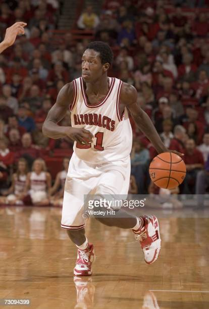 Guard Patrick Beverly of the Arkansas Razorbacks dribbles the ball down the court against the LSU Tigers at Bud Walton Arena on January 20, 2007 in...