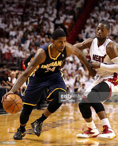 Guard Paul George of the Indiana Pacers is defended by Guard Dwyane Wade of the Miami Heat in Game One of the Eastern Conference Semifinals in the...