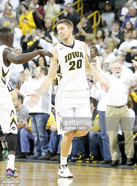 Guard Peter Jok congratulates forward Jarrod Uthoff of the Iowa Hawkeyes after a basket against the Michigan Wolverines in the second half on January...