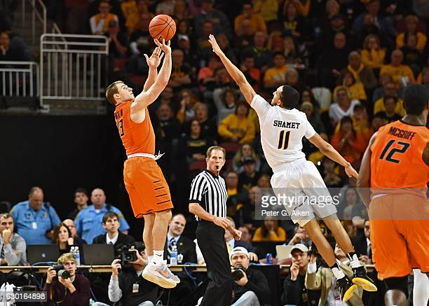 Guard Phil Forte III of the Oklahoma State Cowboys hits a threepoint shot against guard Landry Shamet of the Wichita State Shockers during the second...