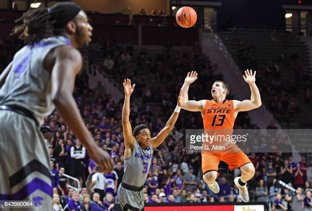 Guard Phil Forte III of the Oklahoma State Cowboys loses control of the ball against guard Kamau Stokes of the Kansas State Wildcats during the first...