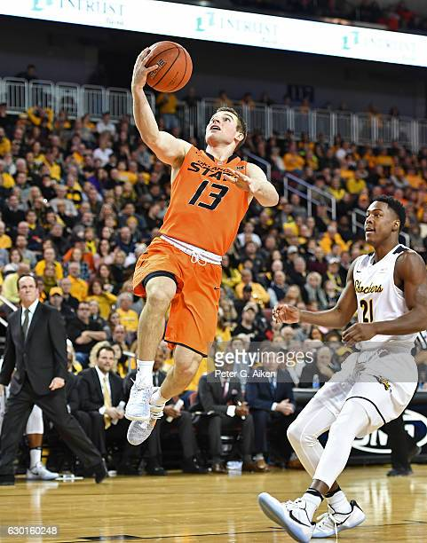 Guard Phil Forte III of the Oklahoma State Cowboys scores with a lay up against the Wichita State Shockers during the first half on December 17 2016...