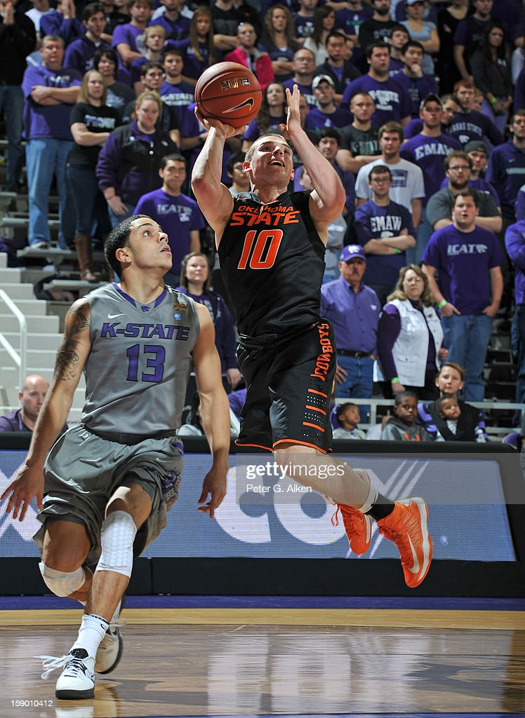 Guard Phil Forte #10 of the Oklahoma State Cowboys drives to the basket against guard Angel Ropdriguez #13 of the Kansas State Wildcats during the first half on January 5, 2013 at Bramlage Coliseum in Manhattan, Kansas. Kansas State defeated Oklahoma State 73-67.