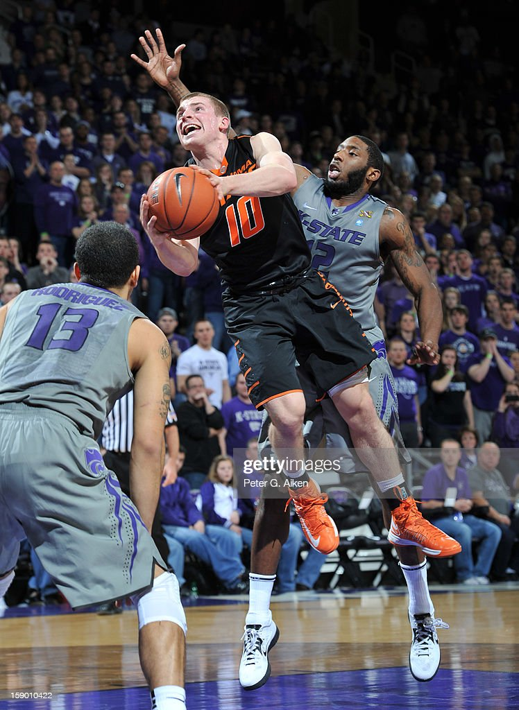 Guard Phil Forte #10 of the Oklahoma State Cowboys drives to the basket against guard Omari Lawrence #12 of the Kansas State Wildcats during the first half on January 5, 2013 at Bramlage Coliseum in Manhattan, Kansas. Kansas State defeated Oklahoma State 73-67.