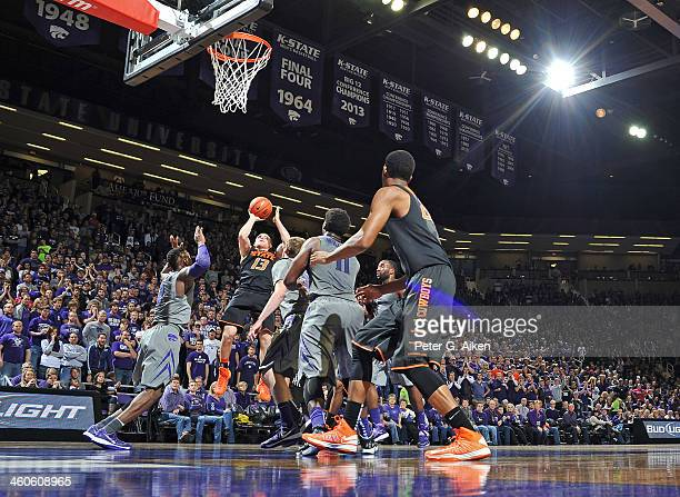 Guard Phil Forte of the Oklahoma State Cowboys puts up a shot against the Kansas State Wildcats during the first half on January 4 2014 at Bramlage...