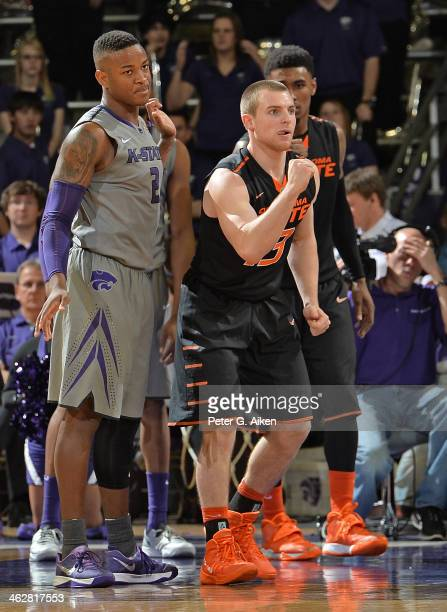 Guard Phil Forte of the Oklahoma State Cowboys reacts after scoring against guard Marcus Foster of the Kansas State Wildcats during the second half...