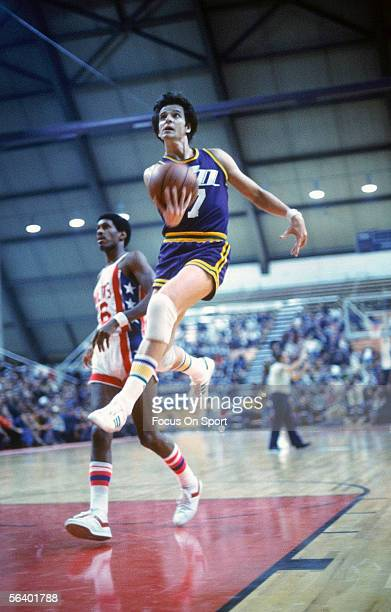 Guard 'Pistol' Pete Maravich of the New Orleans Jazz jumps for a lay up during an NBA game against the New Jersey Nets circa 197779 at the Rutgers...