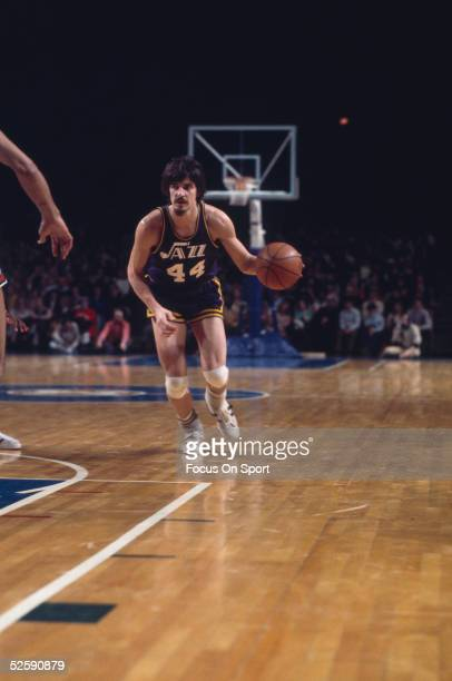 Guard 'Pistol' Pete Maravich of the Utah Jazz dribbles the ball upcourt NOTE TO USER User expressly acknowledges and agrees that by downloading and...