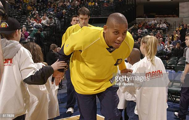 Guard Reggie Miller of the Indiana Pacers runs onto the court during the NBA game against the Toronto Raptors at Conseco Fieldhouse in Indianapolis...