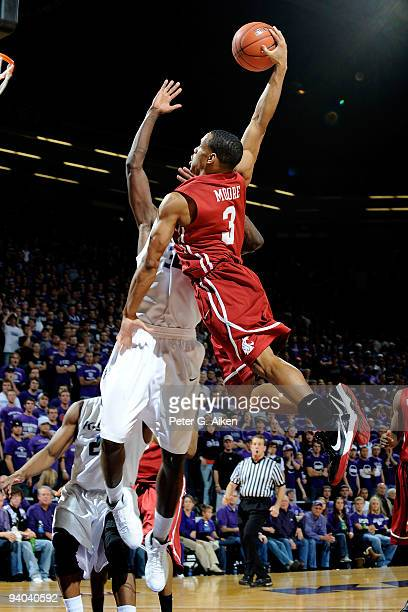 Guard Reggie Moore of the Washington State Cougars drives to the basket against the Kansas State Wildcats in the first half on December 5 2009 in...