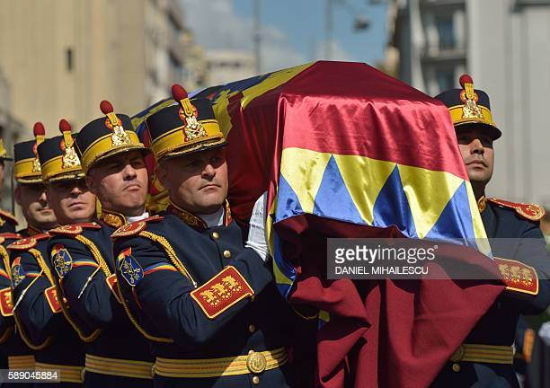 Guard regiment soldiers carry the coffin of late Queen Anne of Romania at the Royal Palace now The Art Museum of Romania as members of the Royal...