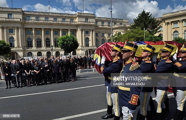 Guard regiment soldiers carry the coffin of the late Queen Anne of Romania at the Royal Palace now The Art Museum of Romania as members of the Royal...