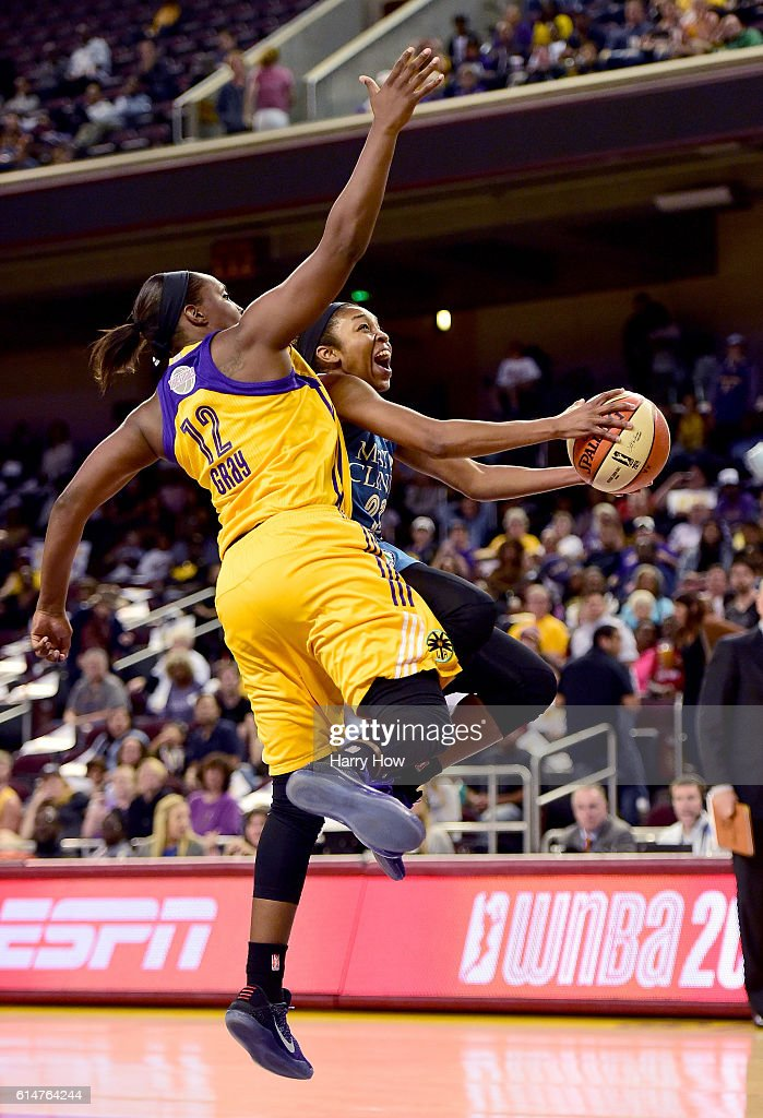 Guard Renee Montgomery #21 of the Minnesota Lynx is fouled by guard Chelsea Gray #12 of the Los Angeles Sparks on a drive to the basket in game three of the 2016 WNBA Finals at Galen Center on October 14, 2016 in Los Angeles, California.