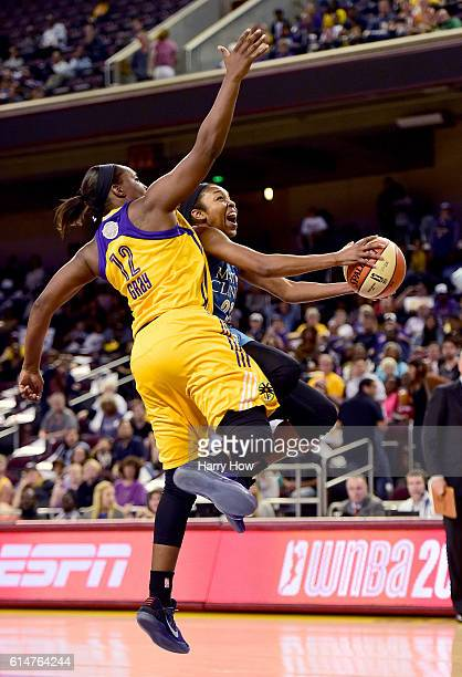 Guard Renee Montgomery of the Minnesota Lynx is fouled by guard Chelsea Gray of the Los Angeles Sparks on a drive to the basket in game three of the...