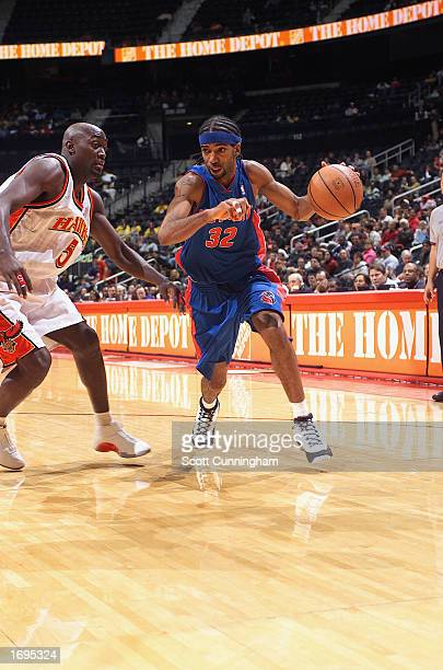 Guard Richard Hamilton of the Detroit Pistons drives around forward Dion Glover of the Atlanta Hawks during the game at Philips Arena on December 7...