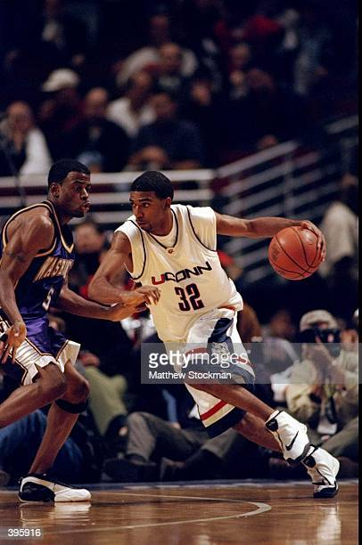 Guard Richard Hamilton of the University of Connecticut Huskies in action against guard Deon Luton of the Washington Huskies during the Great Eight...