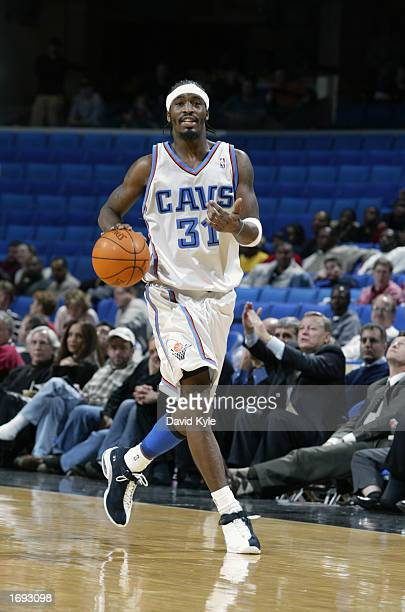 Guard Ricky Davis of the Cleveland Cavaliers dribbles the ball up the floor against the Milwaukee Bucks during the game at Gund Arena on December 9...