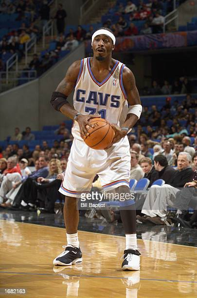 Guard Ricky Davis of the Cleveland Cavaliers looks to pass against the New Orleans Hornets during the game at Gund Arena on November 23 2002 in...