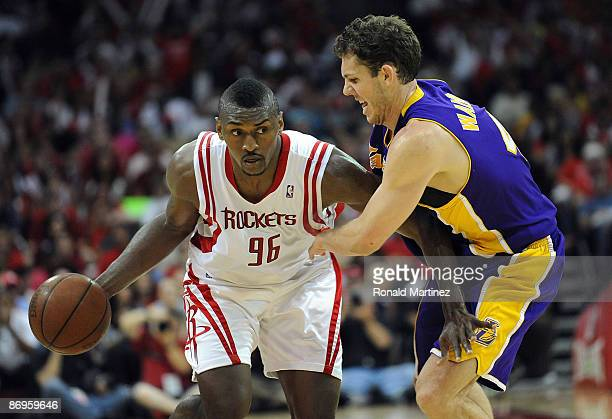 Guard Ron Artest of the Houston Rockets dribbles the ball past Luke Walton of the Los Angeles Lakers in Game Four of the Western Conference...
