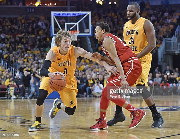 Guard Ron Baker of the Wichita State Shockers drives up court against guard Lorenzo Bonam of the Utah Utes during the first half on December 12 2015...