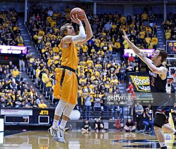 Guard Ron Baker of the Wichita State Shockers put up a shot over guard Ryan McCarthy of the Newman Jets during the second half on November 23 2014 at...