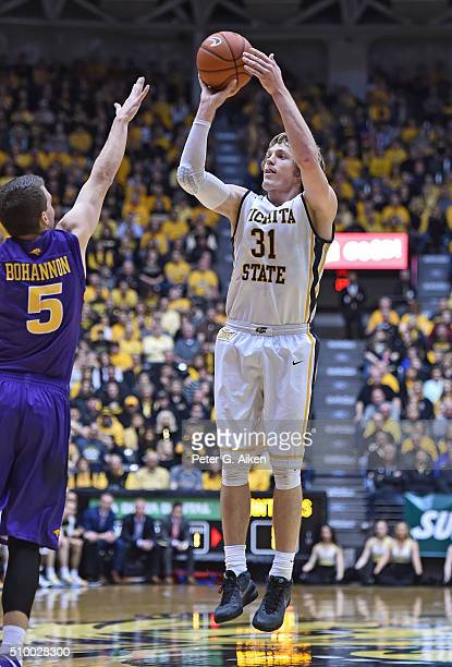 Guard Ron Baker of the Wichita State Shockers puts up a shot against guard Matt Bohannon of the Northern Iowa Panthers during the first half on...
