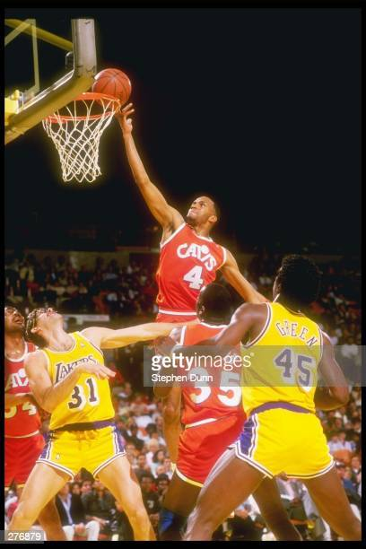 Guard Ron Harper of the Cl:eveland Cavaliers leaps for an easy hoop over the defense of the Los Angeles Lakers during a game at The Forum, in...