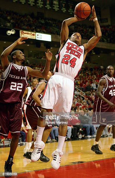 Guard Ronald Ross of the Texas Tech Red Raiders shoots against guard Dominique Kirk of the Texas A&M Aggies on January 15, 2005 at the United Spirit...