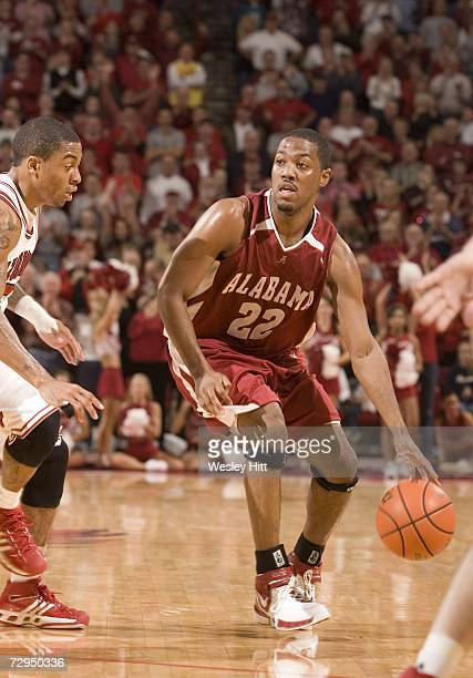 Guard Ronald Steele of the Alabama Crimson Tide dribbles the ball down the court against the Arkansas Razorbacks at Bud Walton Arena on January 6,...