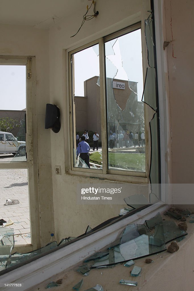 Guard room of company damaged by the workers enraged after death of a labour at under construction building on March 23, 2012 in Gurgaon, India. Labourer Babul Hasan (25) died after falling from the seventh floor of an under-construction multi-storey building.
