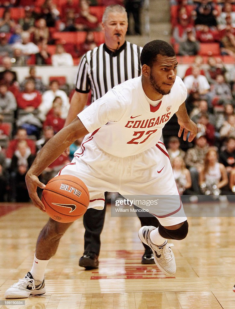 Guard Royce Woolridge #22 of the Washington State Cougars drives the ball against the Colorado Buffaloes during the game at Beasley Coliseum on January 19, 2013 in Pullman, Washington.