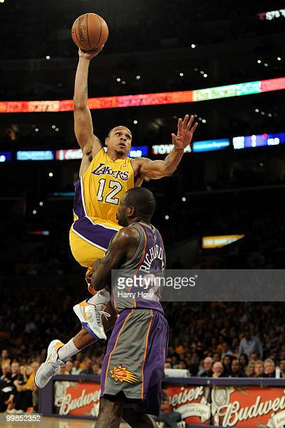 Guard Shannon Brown of the Los Angeles Lakers goes up for a dunk as guard Jason Richardson of the Phoenix Suns defends in Game One of the Western...