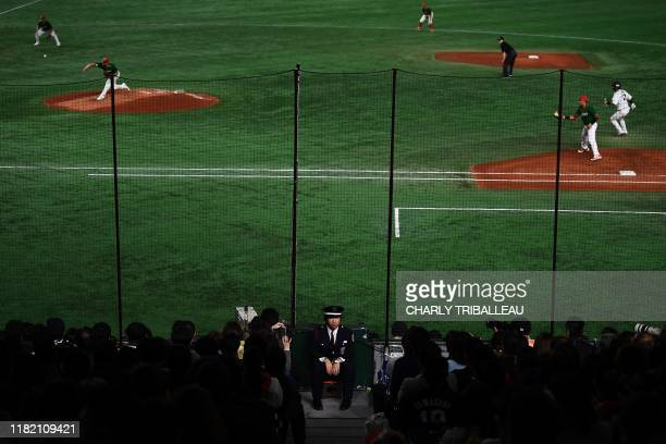 A guard sits during the WBSC Premier 12 Super Round baseball match between Japan and Mexico at the Tokyo Dome in Tokyo on November 13 2019
