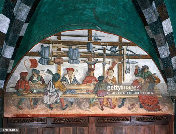 Guard soldiers playing cards 15th century fresco in a lunette of the porch Castle of Issogne Valle d'Aosta Italy
