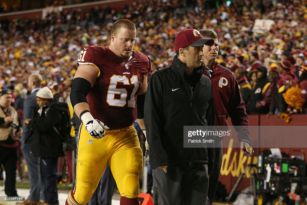Guard Spencer Long #61 of the Washington Redskins walks off the field after being injured against the Green Bay Packers in the second quarter during the NFC Wild Card Playoff game at FedExField on January 10, 2016 in Landover, Maryland.