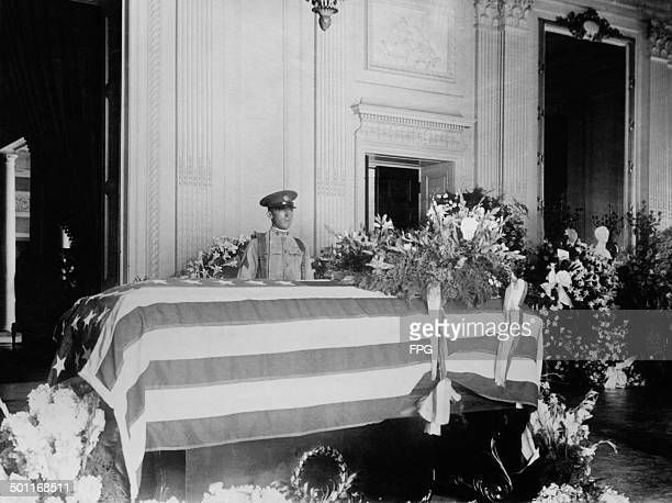 Guard standing by the coffin of US President Warren G Harding in the East Room of the White House, before the President's state funeral, Washington...