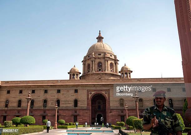 A guard stands at his post in front of the Ministry of Defense in New Delhi India on Wednesday June 24 2009 India should cut interest rates rather...