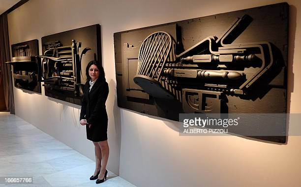 A guard stands by sculptures by US artist Louise Nevelson during the press preview of the 'Louise Nevelson' exhibition on April 15 2013 at the...