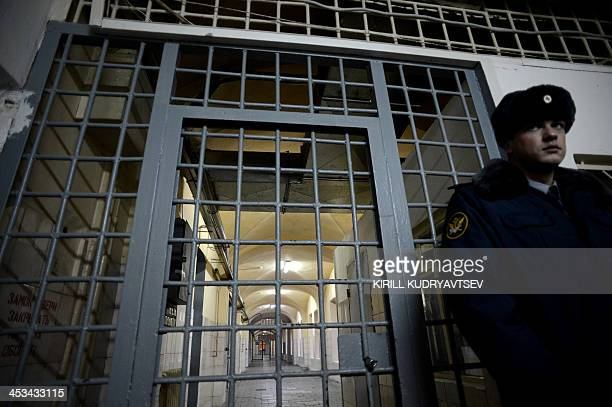 A guard stands in a passage of the notorious Butyrka remand prison in Moscow on December 4 2013 The poster reeads The family life is the only game...