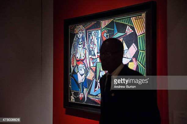 A guard stands next to the art work 'Les femmes d'Alger ' painted by Pablo Picasso at Christie's on May 11 2015 in New York City The painting sold...