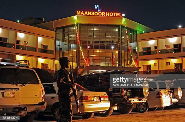 A guard stands outside Mansoor hotel in downtown Hargeisa on May 16 2016 / AFP / MOHAMED ABDIWAHAB