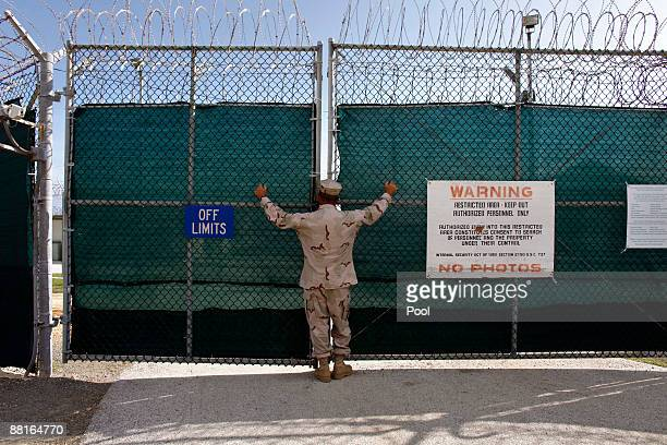 A guard stands outside the gate of Camp Iguana detention facility which houses the Chinese Uighur Guantanamo detainees June 1 2009 at US Naval Base...