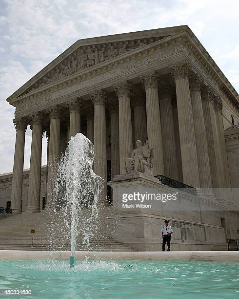 A guard stands outside the US Supreme Court on June 9 2014 in Washington DC The high court ruled today by 7 to 2 margin that homeowners in North...