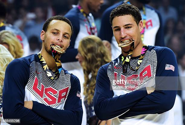 US guard Stephen Curry and US forward Rudy Gay bite their gold medals after winning the 2014 FIBA World basketball championships final match USA vs...