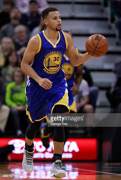 Guard Stephen Curry of the Golden State Warriors brings the ball down court during a game against the Utah Jazz during the second half of an NBA game...